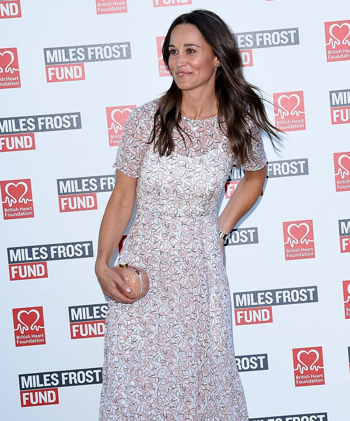 Something to hide? Pippa Middleton made sure her left hand was out of sight when she stepped in London on Monday evening.