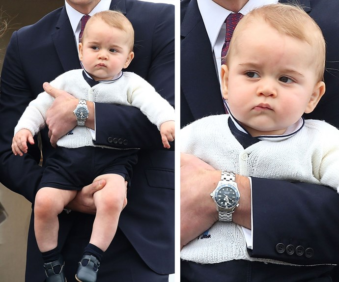 The future King of England casually creates a make-shift throne out of his father's arms while deep in thought.