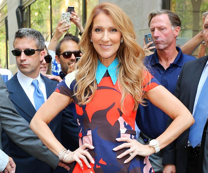 Celine Dion has stepped out in New York City donning a brilliantly bright, multi-coloured dress, but perhaps the star's best accessory is her radiant, ear-to-ear smile.