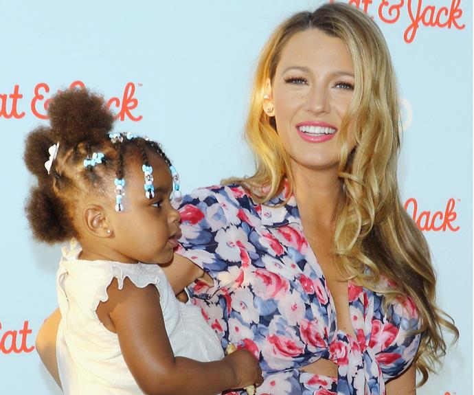 Showing off her maternal side, Blake cuddled up to the gorgeous children at the event.