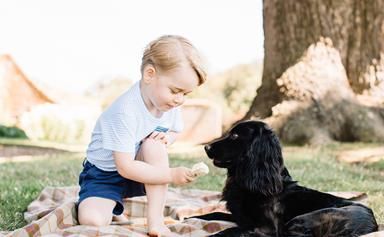 Cheeky Prince George opens his Christmas presents early!