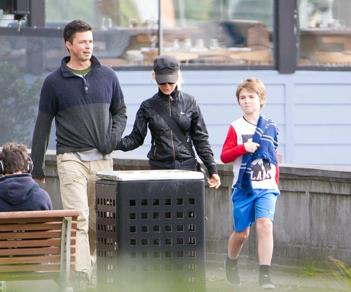 Danielle Spencer and son Tennyson looked right at home with the singer's new partner, Adam Long, in Sydney last week.