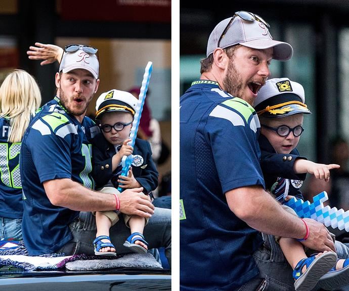 The little tot totally stole the show as he pulled silly faces with his high-profile daddy, playing the role as captain in his pint-sized hat!