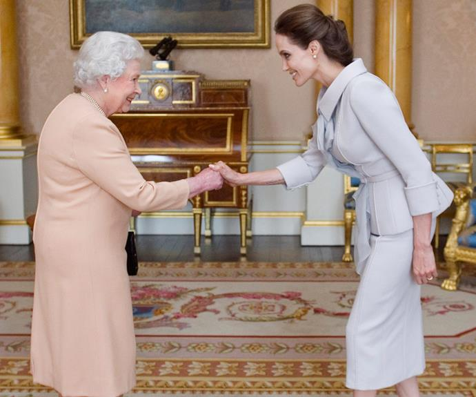 **Angelina Jolie, 2014** Meeting in Buckingham Palace, the longest-reigning monarch presented the actress with the Insignia of an Honorary Dame Grand Cross for her honorable campaign to end war zone sexual violence.