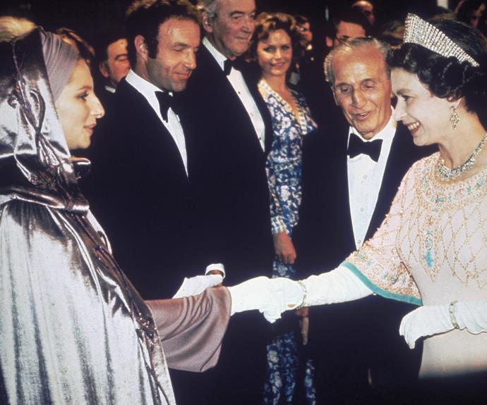 **Barbra Streisand, 1975** Queen Elizabeth II met the singer and actress at the film premiere of *Funny Lady*.