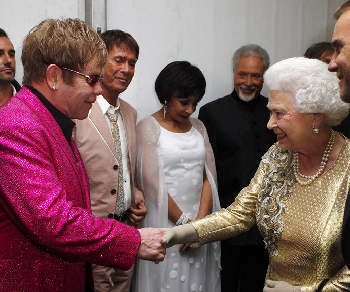 **Elton John, 2012** Dressed in their brightest ensembles, the two Brits shook hands during the Diamond Jubilee Concert in celebration of Her Mejesty's 60th year in reign.