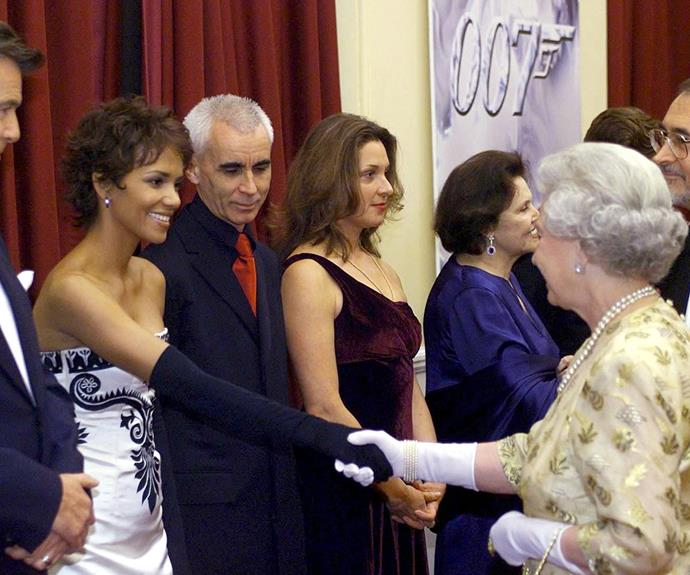 **Halle Berry, 2002** The brunette beauty extended a gloved hand to the matriarch at the  *Die Another Day* London premiere.