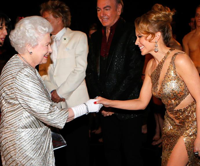 **Kylie Minogue, 2012** Wearing a daring, cut-out dress, the singing budgie shook hands with the royal at the Royal Variety Performance in London.