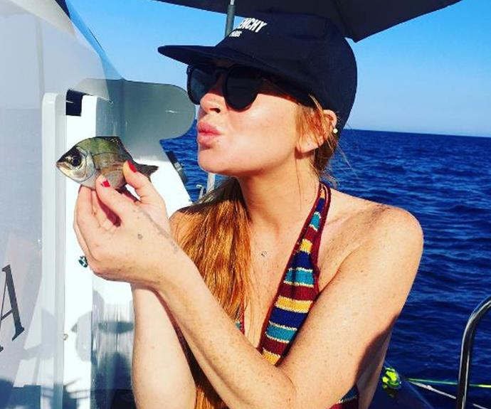 After the claim, she holidayed with friends on a boat, where she was spotted smoking and drinking while sporting a rounded, bump-like belly.