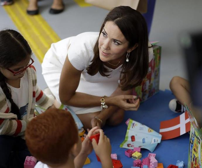 During her visit, the mother-of-four played Lego with the local children.