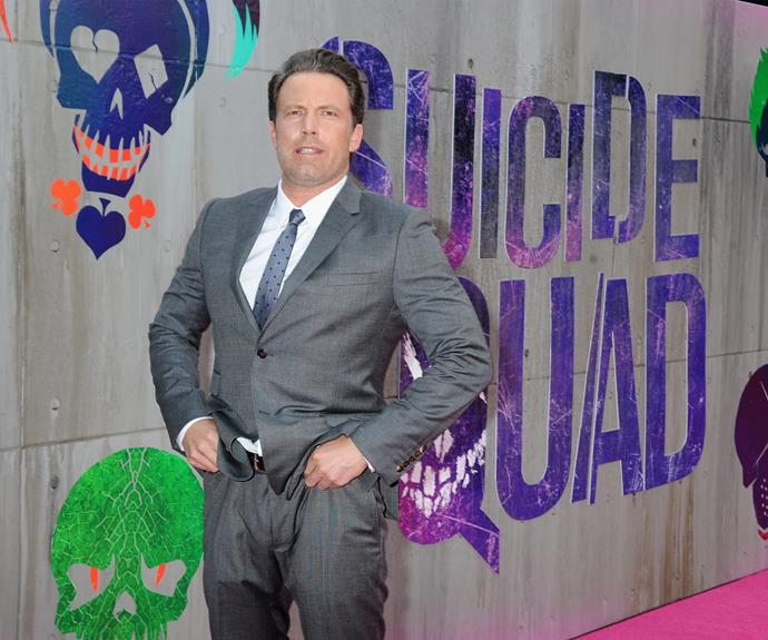 The actor was seen adjusting his suit earlier on the pink carpet for the film.