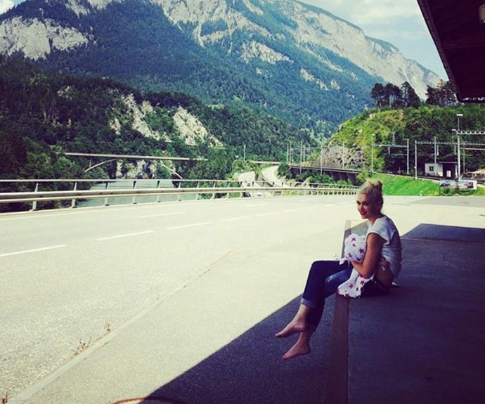**Gwen Stefani** <br><br> In July 2014, Gwen Stefani shared this beautiful candid moment nursing her son Apollo looking over the picturesque Swiss Alps.