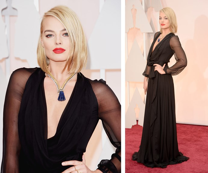 The star looked every bit as glamorous for the 2015 Academy Awards in deep plunge, black gown with a statement red lip.