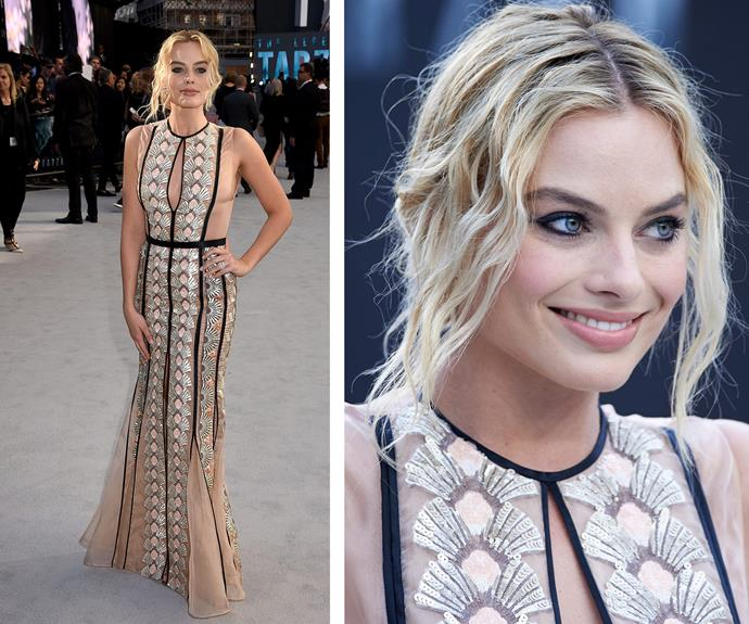 The Aussie stunner stole the red carpet at the London premiere of *Tarzan* in a silver embellished Miu Miu naked dress.