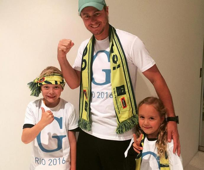 "Lleyton Hewitt and his little ones, Cruz and Ava are voicing their support all the way from Australia for Rio Olympic hopeful, Georgia Baker. The proud dad and his kids donned the green and gold and Georgia-themed shirts as they wished the cyclist all the best for her upcoming race. ""Good luck @georgiabaker_ riding for @ausolympicteam in Rio #gtrain @wsportsandmedia #SwissePoweringDreams,"" he captioned the sweet snap."
