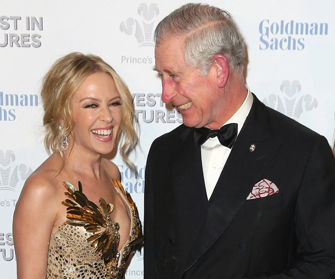 Don't worry, we'd be spinning around too! Miss Kylie Minogue accidentally sends Prince Charles into a giggling tizzy.