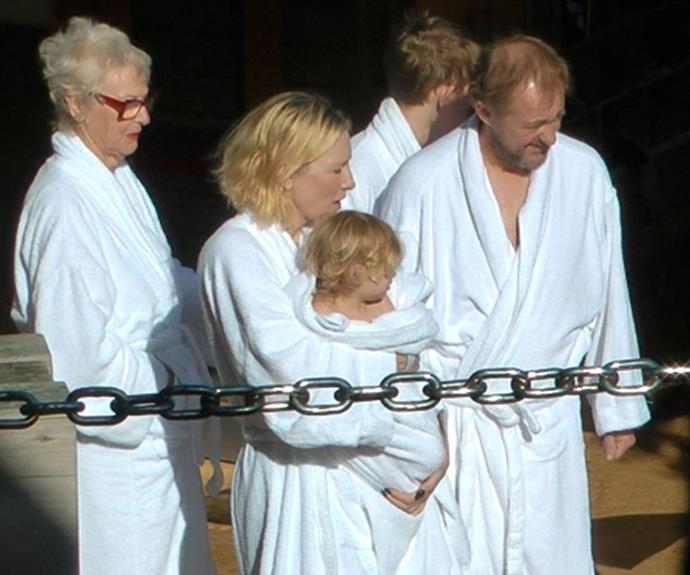 After their dip Cate, Edith and Andrew rugged up in fluffy white robes to keep warm.