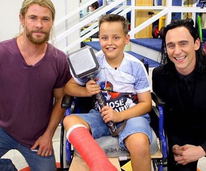 That kid looks pretty thrilled to be holding Thor's hammer!
