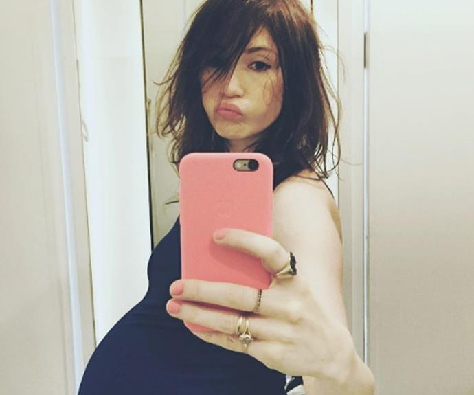 "She shared this image with the caption ""Almost don't fit in the mirror any more!"" not long before the birth."