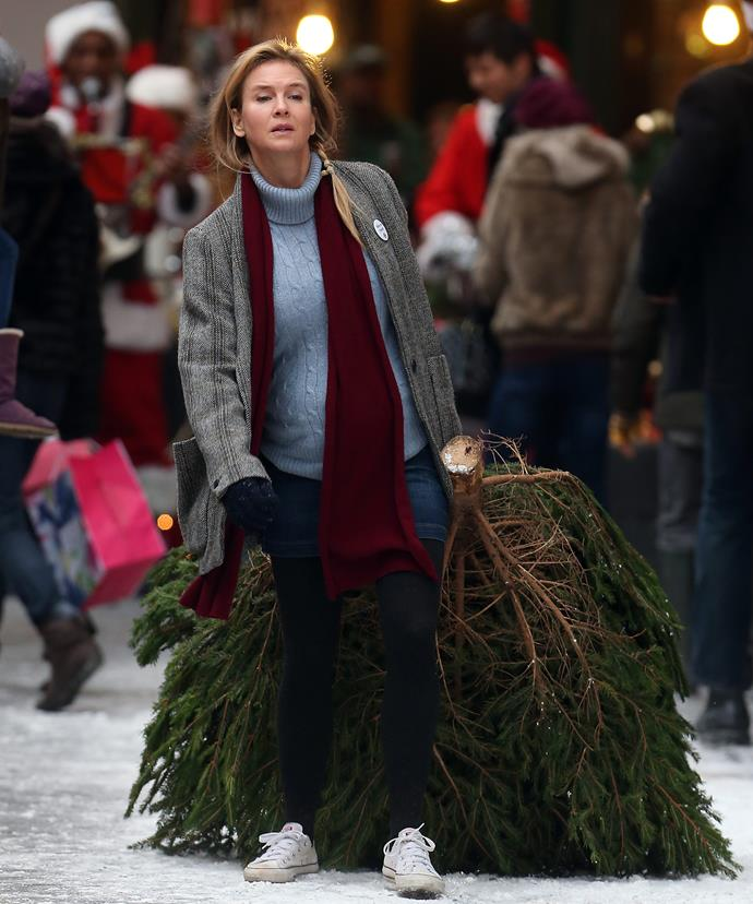 A pregnant Bridget Jones pictured filming a Christmas scene on the streets of London.