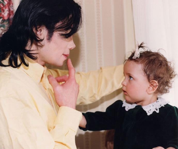 A young Paris with her dad.