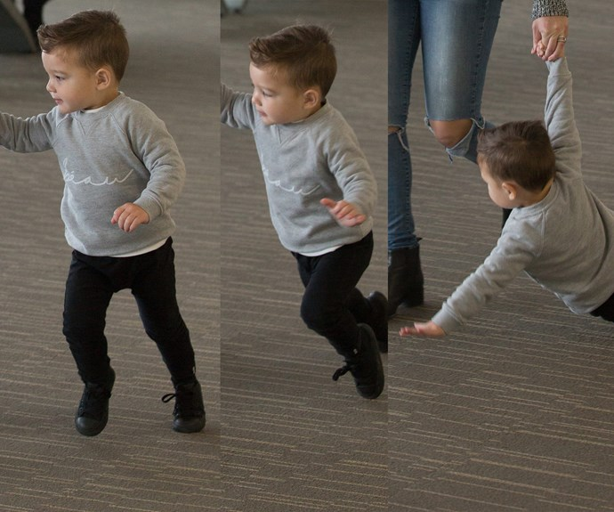 Going, going, gone! While walking through the airport the two-year-old went for a tumble.