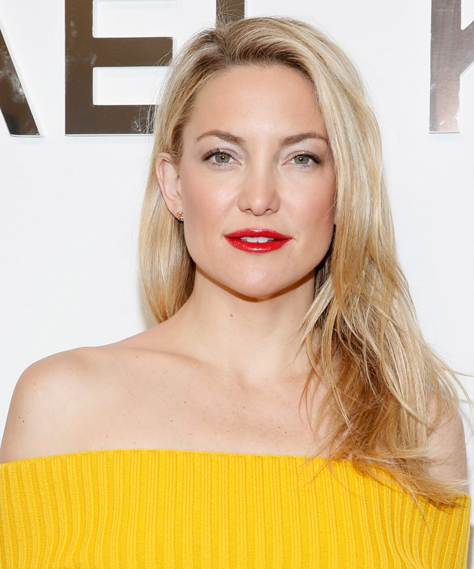 """It has always been pretty simple. I simply apply some sunscreen, use a little blush and lip gloss, and I'm out the door,"" 37-year-old Kate Hudson says of her routine."