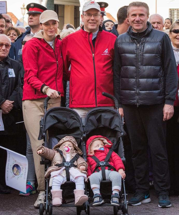 The twins sitting in a stroller, as they join their folks and participate in a climate march in Monaco, last November, ahead of the World Climate Change Conference 2015