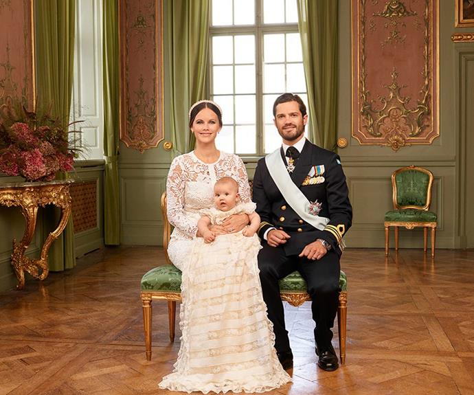 The Swedish Royal Palace released a series of stunning portraits to commemorate Prince Alexander's milestone christening. The darling bubba sat on his mum's lap as dad Prince Carl looked on proudly. *(Images via/kungahuset.se)*