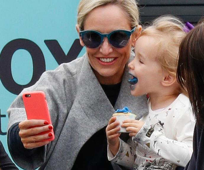 Fifi's three-year-old daughter Trixie is as cute as a cupcake – even with a mouthful of blue icing!