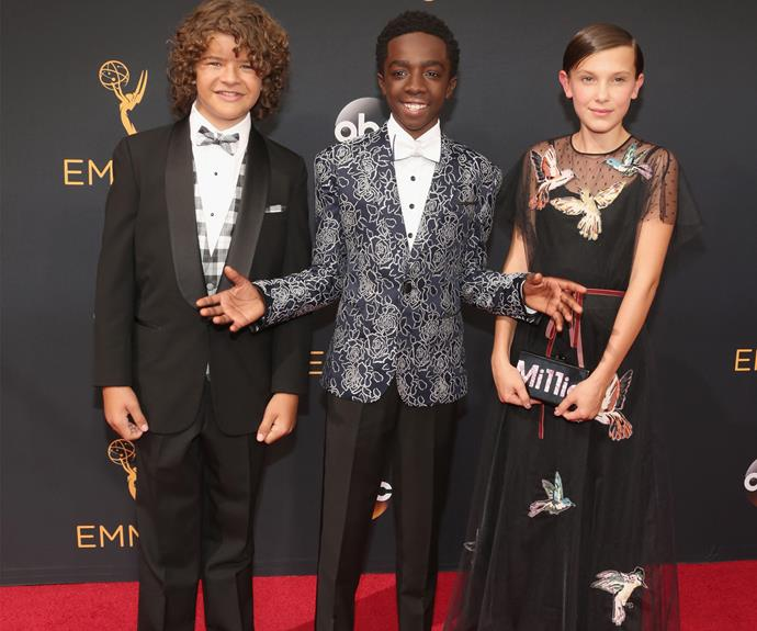 The kids of *Stranger Things* are in the house! **WATCH the trio joke about in the next slide. Gallery continues!**