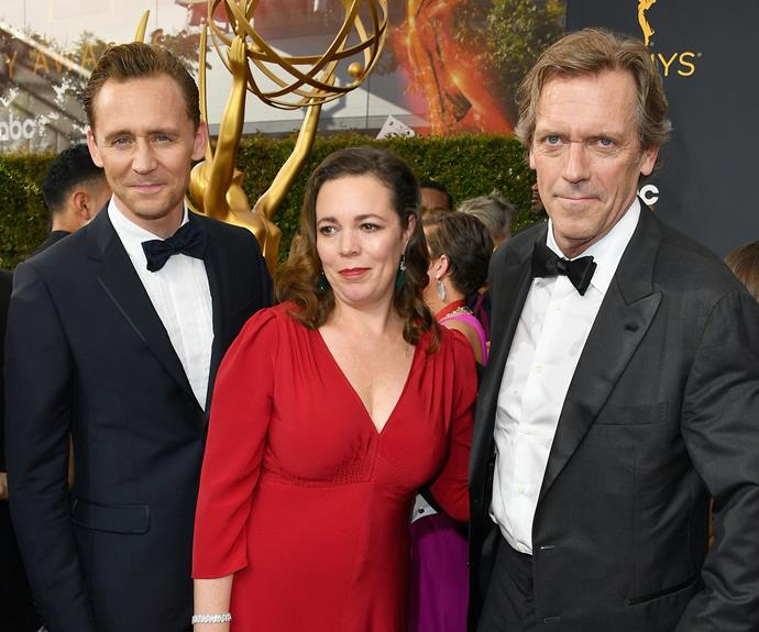 The newly single star posed for pictured with co-stars Olivia Colman and Hugh Laurie.