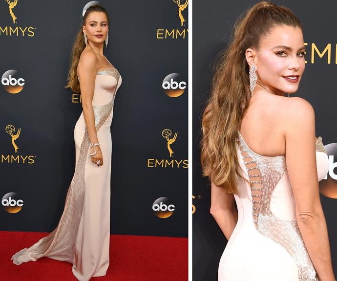 Sofia Vergara threw her luscious locks up into a high pony tail and flaunted her toned physique in a sexy strapless number.