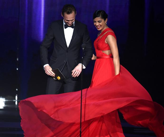 Tom Hiddleston has the perfect remedy for his new found single status... a breathtaking co-host in Priyanka Chopra!