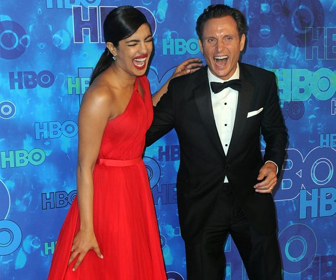 Priyanka Chopra seemed to have Hollywood's finest men completely smitten! Here, she squeezes a quick red carpet chuckle with *Scandal's* Tony Goldwyn.