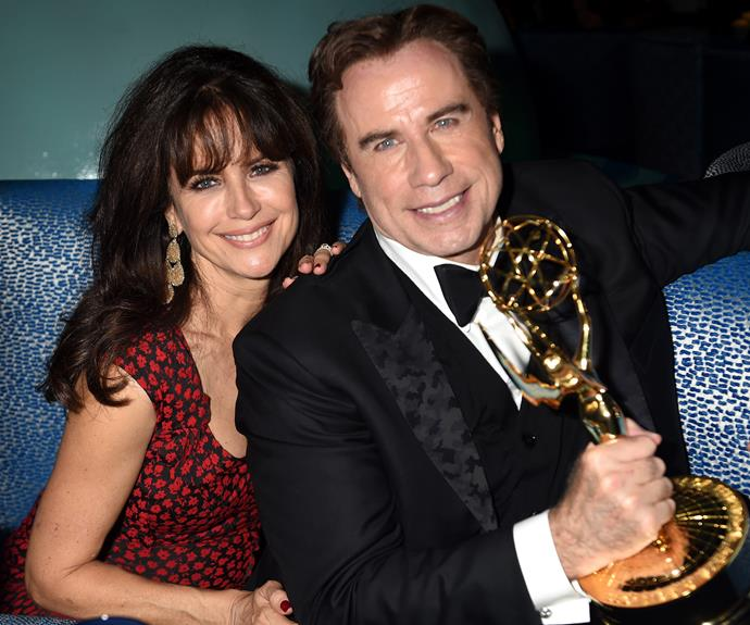 John Travolta with his wife Kelly... The actor holds one of the Emmys that *The People v. O.J. Simpson* won. The 62-year-old played Robert Shapiro on the show.