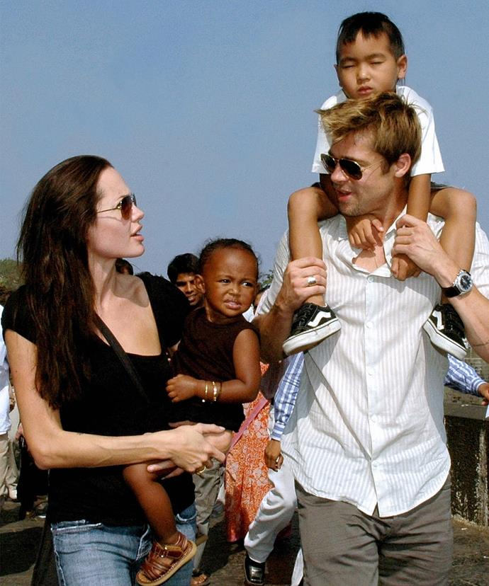 Angelina and Brad with Maddox and Zahara as they take a stroll on the seafront promenade in Mumbai.