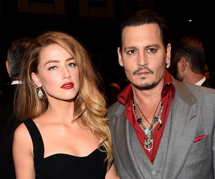 """After months of fighting it out in court, Johnny Depp and Amber Heard finally [reached a divorce settlement](http://www.womansday.com.au/celebrity/hollywood-stars/johnny-depp-and-amber-heard-reach-divorce-settlement-16243
