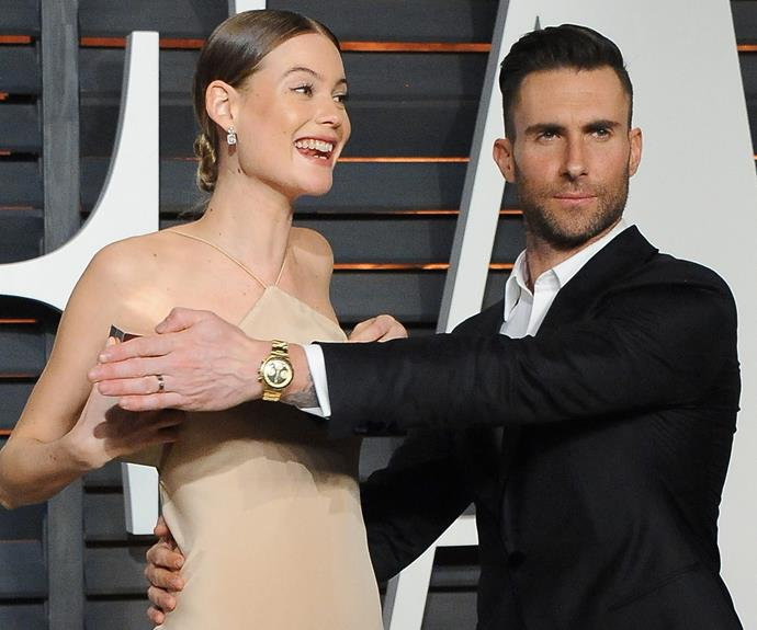 Adam playfully protected his lady after a wardrobe malfunction.