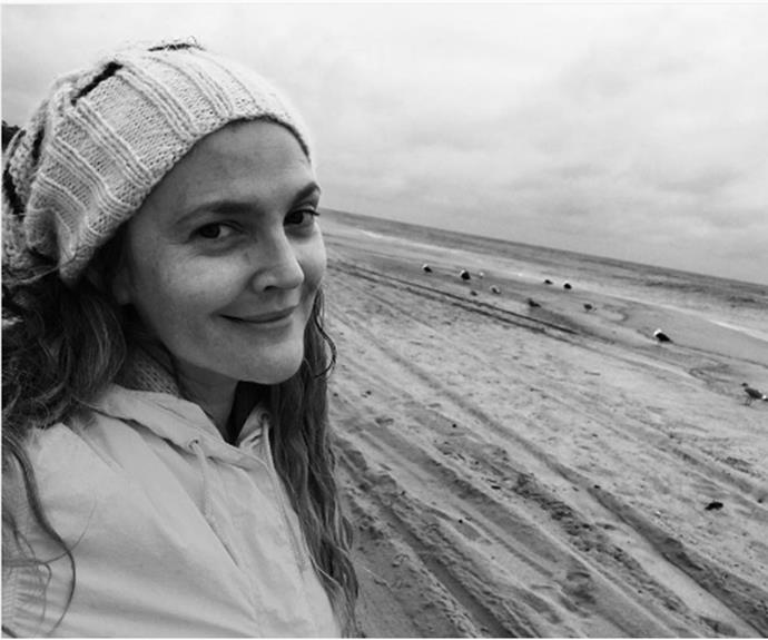 """Drew Barrymore is the latest in a long list of celebs to embrace the no makeup selfie. The 41 year-old was enjoying a day on the beach when she uploaded this stunning black and white snap to Instagram, along with the caption """"Happy Sunday everyone! Happy Sunday!"""" With her hair worn loose and paired with a comfy beanie, we think the *Charlie's Angel's* star looks the epitome of casual-chic!"""