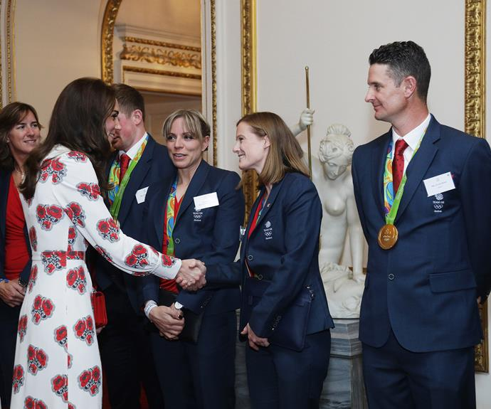 Kate meets athletes at a reception hosted at  Buckingham Palace.