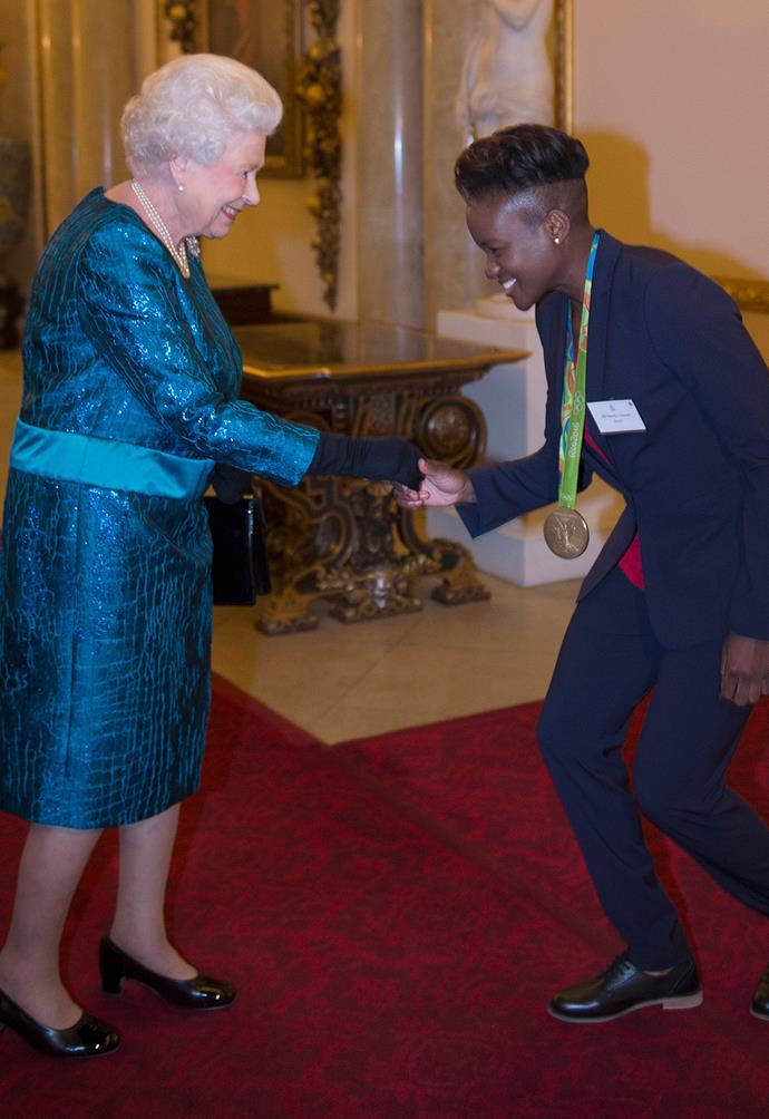 Queen Elizabeth II speaks with British athlete, Nicola Adams.