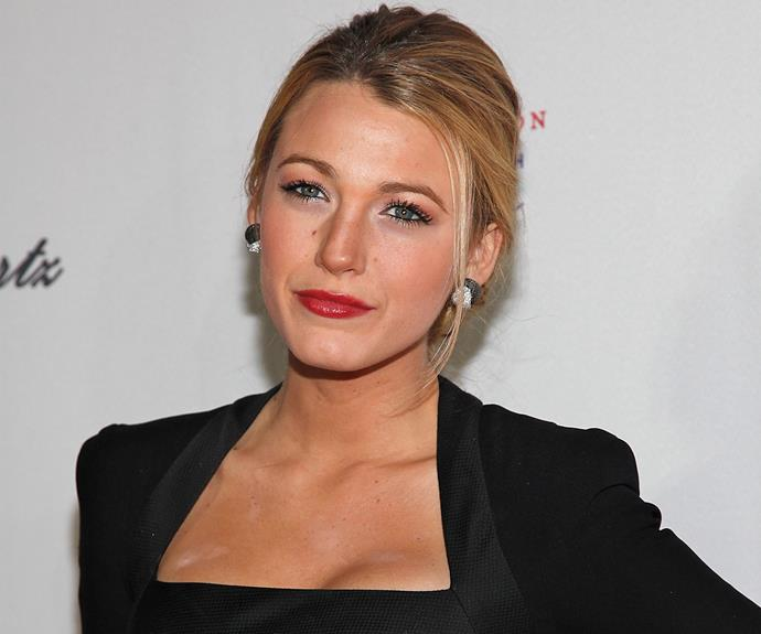 The ever beautiful Blake Lively may boast her flawless face in this red-lipped look, but fans were quick to spot the mysterious dusting on her chest area.