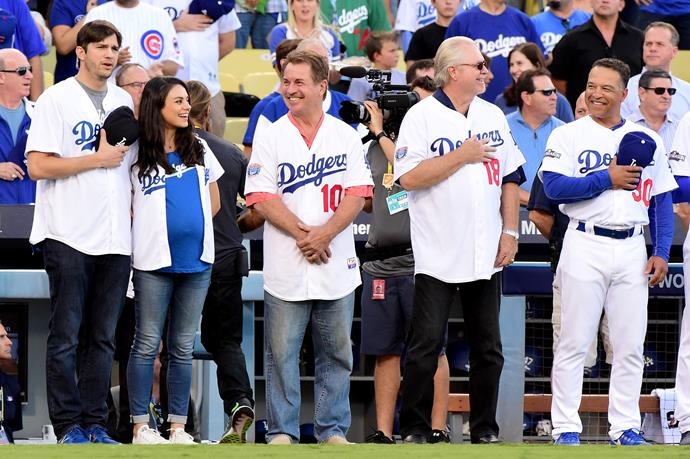 The sports-loving duo took to the field to sing the national anthem with both past and present Dodgers champions.