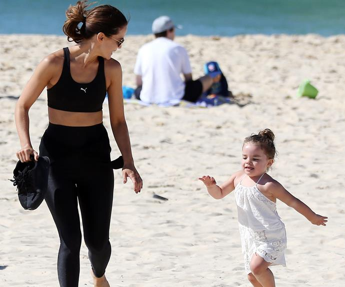 The mother-daughter duo burnt some energy as they ran around the sand.