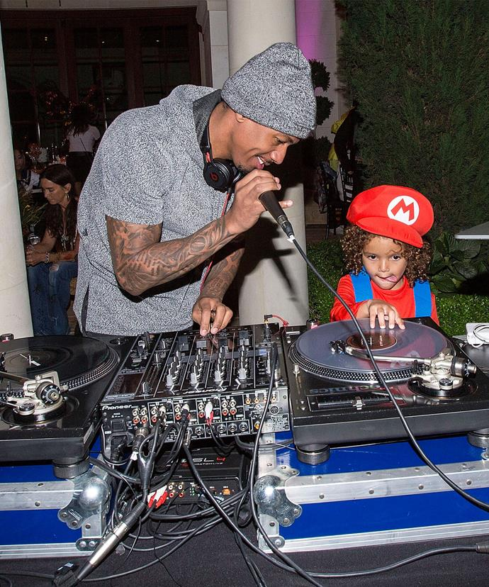 Nick taught his son how to work the DJ decks.