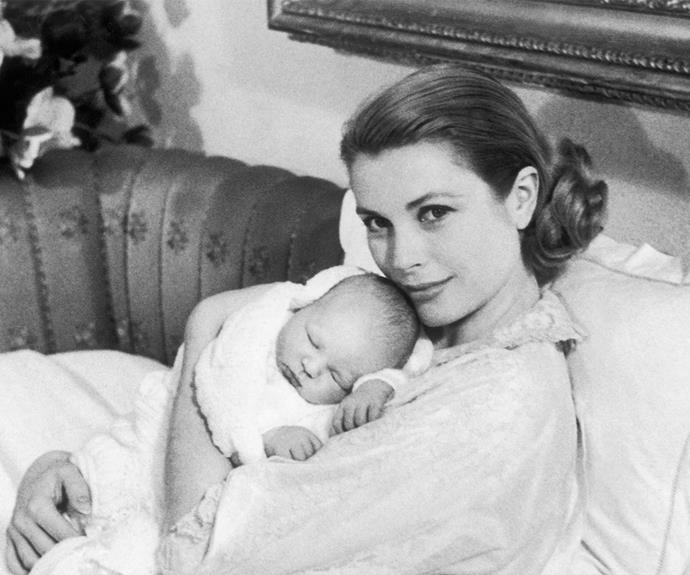Princess Grace of Monaco and her first-born, Prince Albert, share a loving moment in 1958.