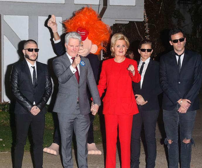 "Although she technically went to the bash with ""husband"" Bill Clinton, Katy's real-life boyfriend, Orlando Bloom, followed closely in an obnoxious Trump mask!"