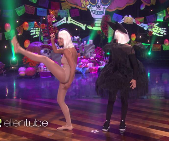 Ellen DeGeneres pulled out all the stops when she stepped on stage dressed as singer Sia. And since the *Chandelier* hitmaker is never seen without her dancer Maddie Ziegler, Ellen rustled up Heidi Klum to play the part! **WATCH the pair perform in the next slide!**