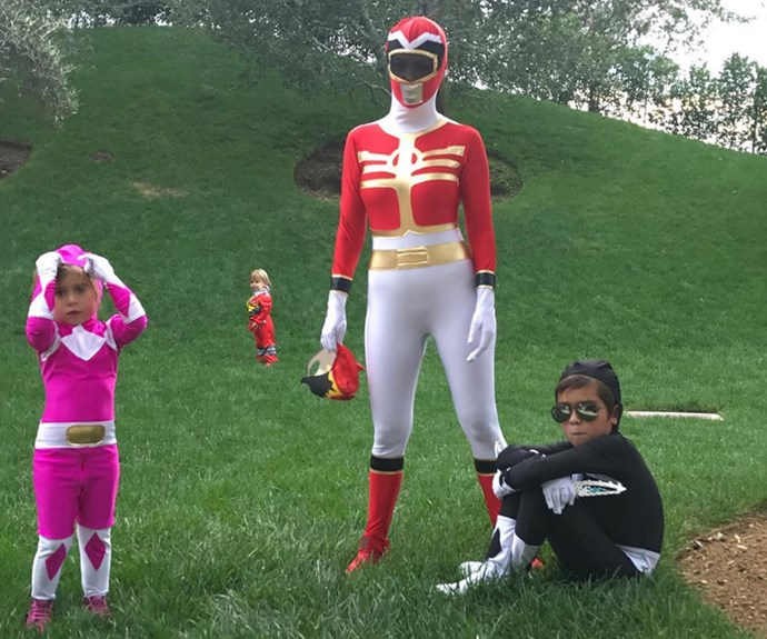 """Kourtney Kardashian and her kids Mason, Penelope and Reign sported matching Power Ranger unitards. """"Happy Halloween!! May the power be with you,"""" she wrote besides this happy snap."""